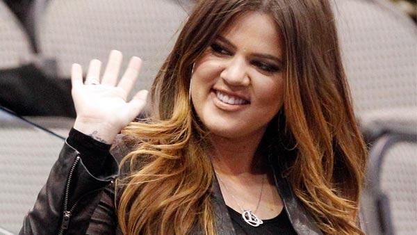 Khloe Kardashian waves to fans before an NBA preseason basketball between the Oklahoma City Thunder and Dallas Mavericks game in Dallas, Sunday, Dec. 18, 2011. - Provided courtesy of AP / LM Otero