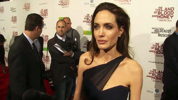 Angelina Jolie talks to OnTheRedCarpet.com at the Los Angeles premiere of her film In The Land of Blood and Honey on Dec. 8, 2011. - Provided courtesy of OTRC