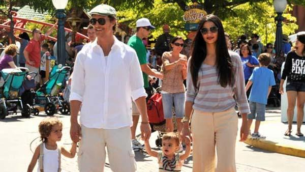 Matthew McConaughey and girlfriend Camila Alves stroll through Mickeys Toontown with their children, son Levi (born July 2008), and daughter Vida (born January 2010), on Wednesday, June 15, 2011. - Provided courtesy of Lisa Rose / Walt Disney Company