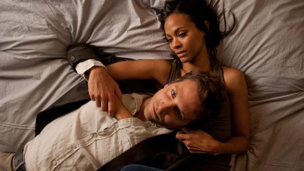 Bradley Cooper and Zoe Saldana appear in a still from the 2012 film, The Words. - Provided courtesy of Benaroya Pictures / Jonathan Wenk