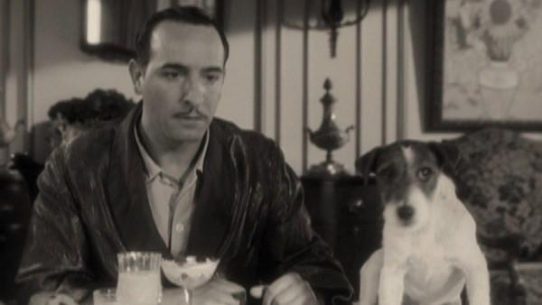 Jean Dujardin and Uggie the Jack Russell terrier appear in a scene from the 2011 movie The Artist. - Provided courtesy of The Weinstein Company