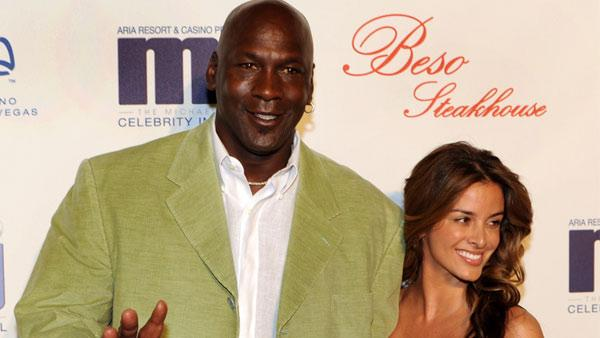 In this photo provided by the Las Vegas News Bureau, basketball great Michael Jordan and his girlfriend Yvette Prieto arrive for a celebrity dinner at Beso inside Crystals in City Center Thursday, March 31, 2011.