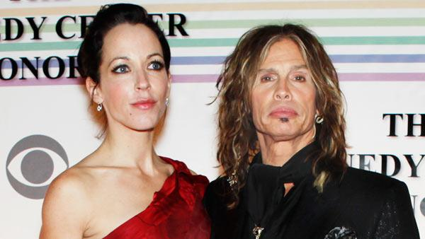In this Dec. 10, 2010 file photo, Erin Brady, left, and Steven Tyler of Aerosmith, walk the red carpet at the Kennedy Center Honors in Washington. Tyler's representative confirmed Monday, Jan. 2, 2012, that the Aerosmith frontman is engaged to Erin Brady.