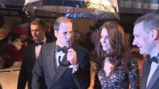 Prince William appears to reject an umbrella, as his wife Kate accepts one on the red carpet of the UK premiere of War Horse in London on Sunday, Jan. 8, 2012. - Provided courtesy of none / DreamWorks SKG