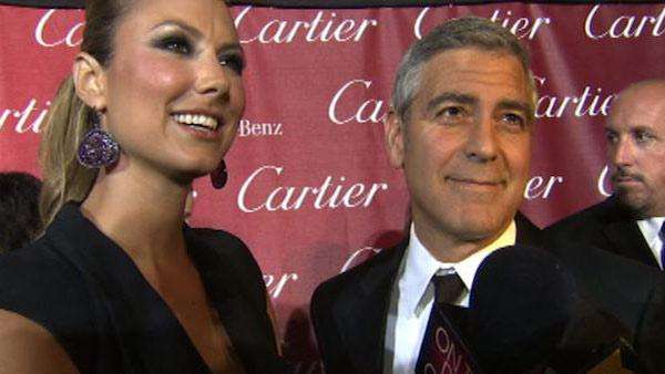 George Clooney talks to OnTheRedCarpet.com at the Palm Springs International Film Festival on Jan. 7, 2012. Pictured on the left is his girlfriend, former WWE star Stacy Keibler.