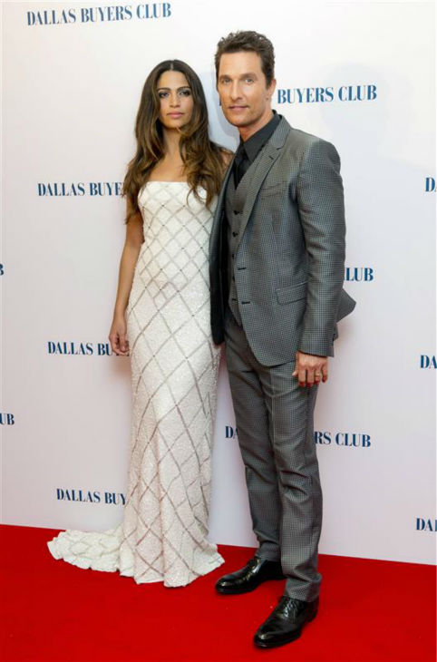 Matthew McConaughey and wife Camila Alves, wearing a Pamella Roland gown, appear at the premiere of 'Dallas Buyers Club' in London on Jan. 39, 2014. He is nominated for his first Oscar for his roles as an HIV-positive patient.