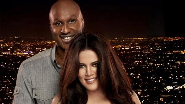 Television personality Khloe Kardashian and husband Lamar Odom appear in a promotional photo for their series Khloe & Lamar. - Provided courtesy of E!