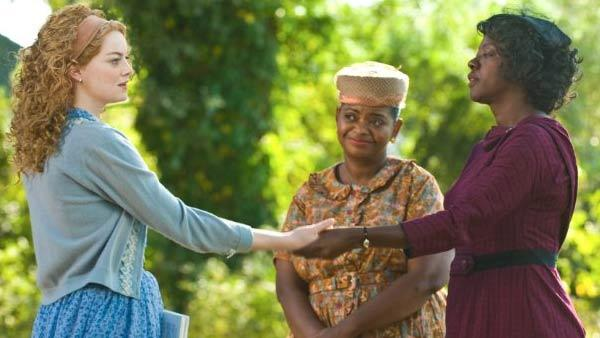 Viola Davis, Emma Stone and Octavia Spencer appear in a scene from the 2011 film The Help. - Provided courtesy of DreamWorks Pictures / Film Frame