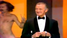 David Nevin is interupted at the 46th Academy Awards in 1974 by a streaking Robert Opel.