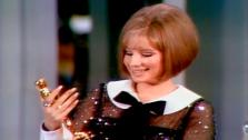 Barbra Streisand accepts a Best Actress Oscar for Funny Girl.