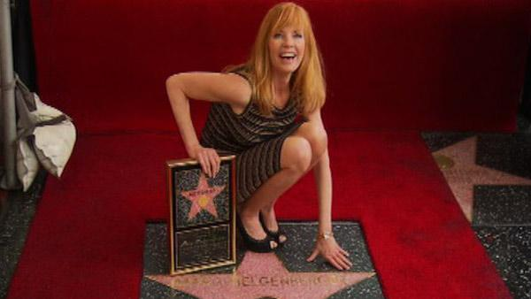 Marg Helgenberger of 'CSI: Crime Scene Investigation' poses on her star on the Hollywood Walk of Fame on Jan. 23, 2012.
