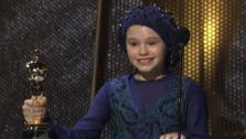 Anna Paquin, seen here at age 11, gives a speech accepting an Oscar for her role in The Piano at the 66th Academy Awards in Los Angele