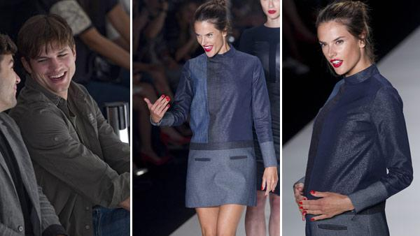Ashton Kutcher, right, smiles as he attends the presentation of the Colcci collection at the Sao Paulo Fashion Week in Sao Paulo, Brazil on Jan. 22, 2012. / Brazilian model Alessandra Ambrosio, who is pregnant, gestures to Kutcher at the fashion show. - Provided courtesy of AP / Andre Penner