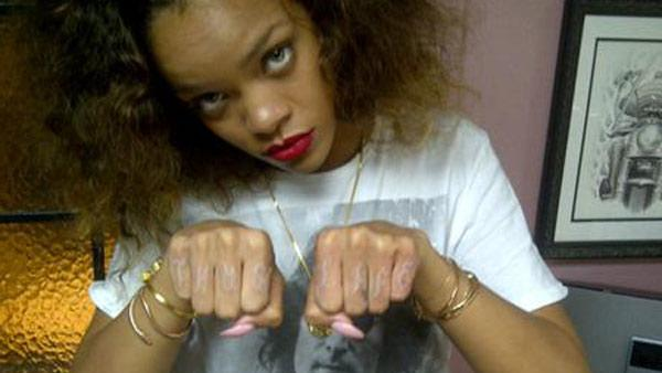 Rihanna appears in this photo posted on her Twitter page, sporting the words Thug Life across eight of her knuckles. - Provided courtesy of lockerz.com/s/177609408