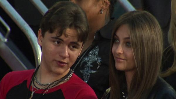 Michael Jackson's son and Prince talks to his sister Paris at the King of Pop's hand and footprint ceremony at the Grauman's Chinese Theatre on Jan. 26, 2012.