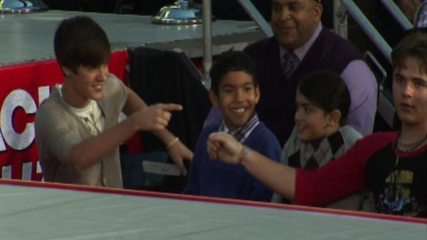 Justin Bieber (left) gestures at Prince Jacksonn, the son of Michael Jackson, after shaki