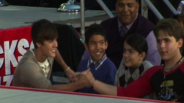 Justin Bieber (left) shakes the hand of Pri