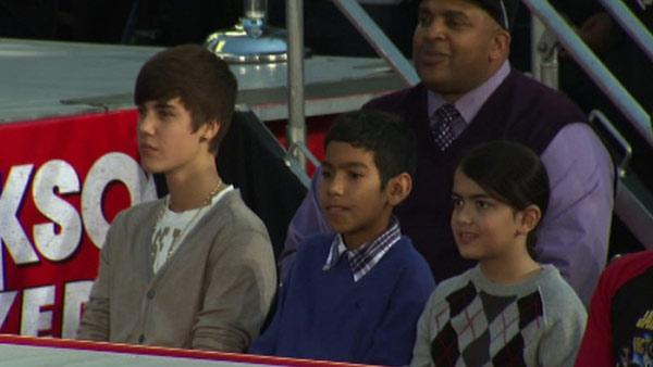 Justin Bieber (left) watches performers on stage at Micha