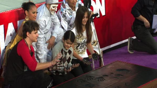 Michael Jackson's children Prince (left), Blanket (middle) and Paris wipe their hands after placing them in cement along an imprint of their father's sequined globe and dance shoes at a ceremony at the Grauman's Chinese Theatre on Jan. 26, 2012.