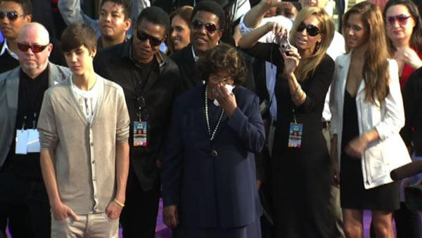 Justin Bieber and Michael Jackson's mother Katherine watch as the