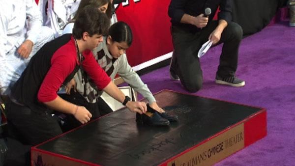 Prince and Blanket Jackson place their late father Michael Jackson's dance shoes in cement at the King of Pop's hand and footprint ceremony at the Grauman's Chinese Theatre on Jan. 26, 2012.