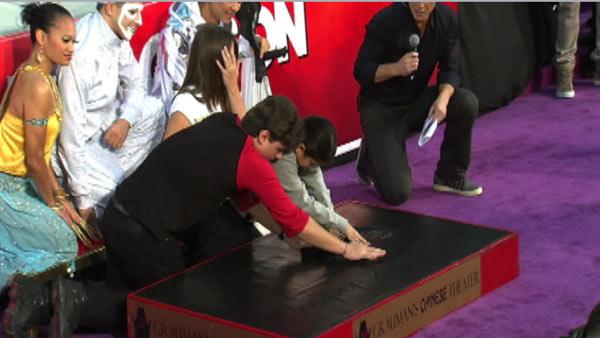 Prince and Blanket Jackson place their late father Michael Jackson's dance shoes in cement at the King o