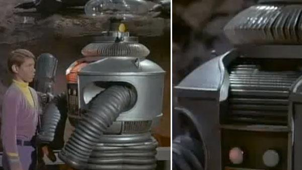 Billy Mumy appears as Will Robinson alongside The Robot, portrayed in person by Bob May and voiced by Dick Tufeld, in an episode of the 1960s sci-fi series 'Lost In Space.'