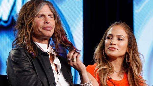 American Idol Judge and musician Jennifer Lopez, right, plays with the hair of fellow judge Steven Tyler of Aerosmith at the American Idol panel at the Fox Television Critics Association Winter Press Tour in Pasadena , Calif. on Sunday, Jan. 8, 2012. - Provided courtesy of AP / Danny Moloshok