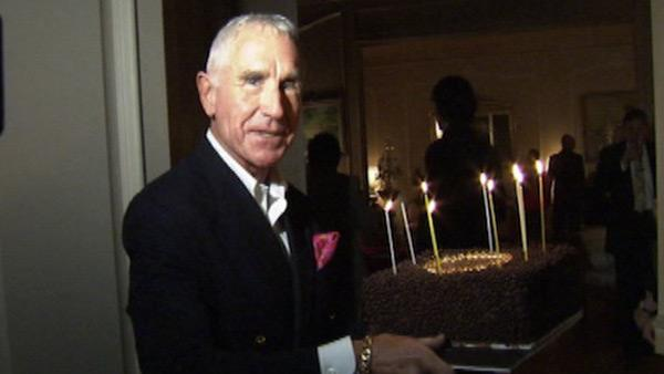 Frederic Prinz von Anhalt carries a chocolate birthday cake made by Wolfgang Puck at his wife Zsa Zsa Gabor's 95th birthday party at their Bel-Air home on Feb. 6, 2012. The ailing actress was kept behind closed doors.