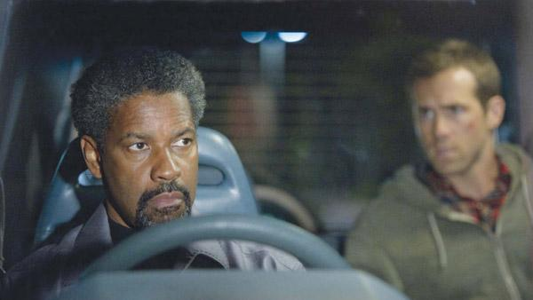 Ryan Reynolds and Denzel Washington appear in a still from Safe House. - Provided courtesy of Universal Pictures