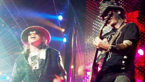 Axl Rose and guitarist DJ Ashba appear at a Guns N' Roses concert at Sprint Center in Kansas City, MO on Nov. 12, 2012.