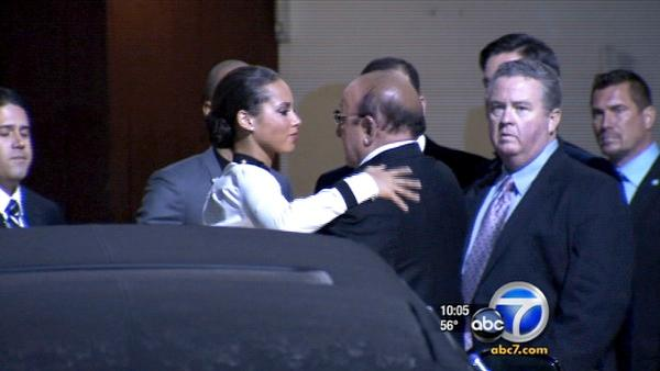 Alicia Keys hugs Clive Davis outside hotel