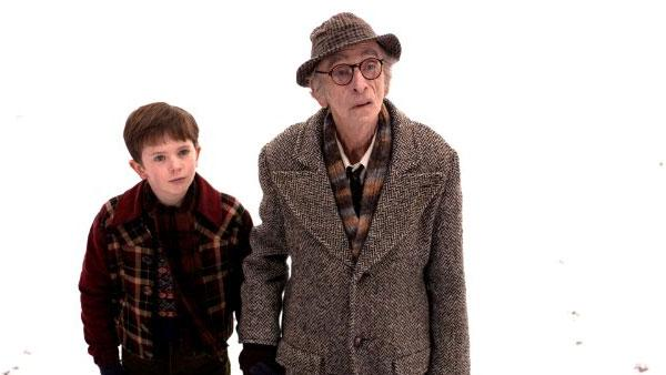 Freddie Highmore (left) and David Kelly (right) in a scene from the 2005 film 'Charlie and the Chocolate Factory.'