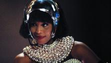 Whitney Houston appears in a scene from the 1992 movie The Bodyguard. She played a singer who falls in love with her bodyguard, who is portrayed by Kevin Coster. - Provided courtesy of Warner Bros. Pictures