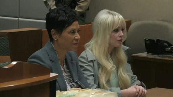 Lindsay Lohan sits by her lawyer, Shawn Holley, at a Los Angeles court on Feb. 22, 2012.