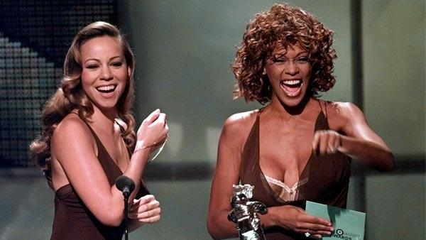 In this Sept. 10, 1998 file photo, Mariah Carey, left, and Whitney Houston present the award for Best Male Video during the MTV Video Music Awards, in Universal City, Calif. - Provided courtesy of AP / Kevork Djansezian