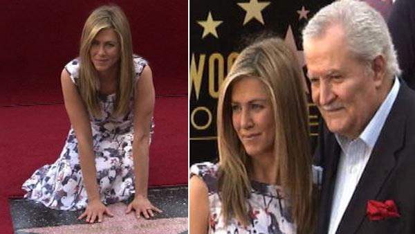 Jennifer Aniston gets star, poses with dad