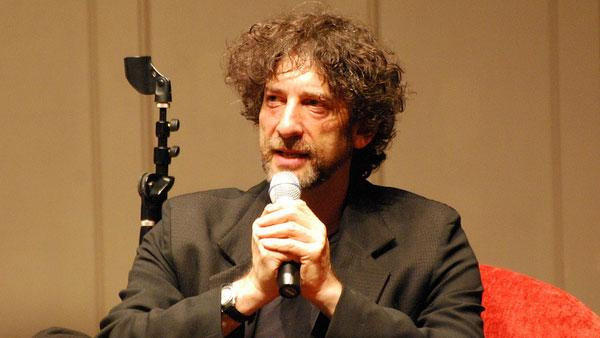 Neil Gaiman talks to fans at an event to promote his book 'American Gods' in Seattle in June 20