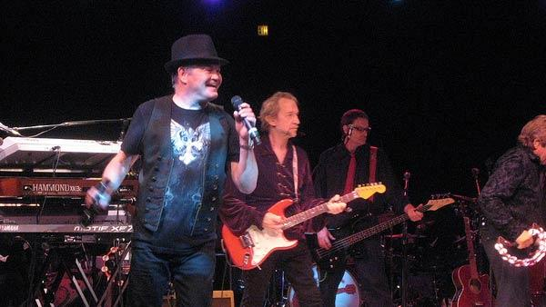 From left: Micky Dolenz, Peter Tork, guest bassist and Davy Jones appear in concert in