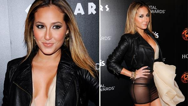 Singer Adrienne Bailon attends Caesars Entertainment Escape to Total Rewards kick-off at Gotham Hall on Thursday, March 1, 2012 in New York. - Provided courtesy of AP / Evan Agostini