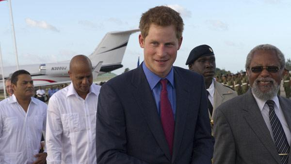 Britains Prince Harry as he arrives at Philip Goldson International Airport, Ladyville, Belize, where he was met by the Governor General of Belize, Sir Colville Young at the start of his tour to mark the Queens Diamond Jubilee, Friday March 2, 2012. - Provided courtesy of AP / Arthur Edwards