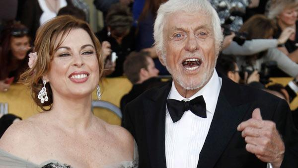 Dick Van Dyke, right, and a guest arrive at the 18th Annual Screen Actors Guild Awards on Sunday Jan. 29, 2012 in Los Angeles. - Provided courtesy of AP / Matt Sayles
