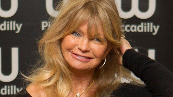 U.S actress Goldie Hawn arrives to sign copies of her new book, 10 Mindful Minutes, in collaboration with acclaimed British poet Wendy Holden, at a book store in Piccadilly, London, Wednesday, Mar. 7, 2012. - Provided courtesy of AP / Joel Ryan