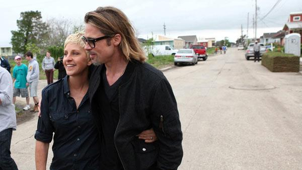 In this photo released by Warner Bros., talk show host Ellen DeGeneres walks with Brad Pitt in the Lower Ninth Ward in New Orleans, during the taping of The Ellen DeGeneres Show, on Friday, March 9, 2012. - Provided courtesy of AP / AP Photo/Warner Bros., Michael Rozman