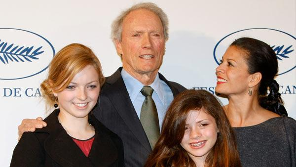 US actor Clint Eastwood, center background, poses for photographers with his wife Dina, right background, his daughters, Francesca, left, and Morgan, in Paris, Wednesday, Feb. 25, 2009. - Provided courtesy of AP / Thibault Camus