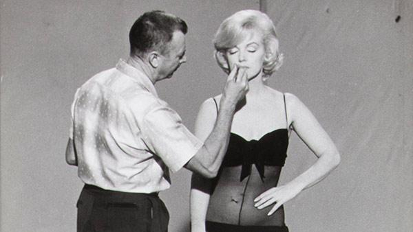 This image, taken in 1960, released by Juliens Auctions, shows Allan Whitey Snyder applying Marilyn Monroes makeup on the set of Lets Make Love. - Provided courtesy of AP / Juliens Auctions