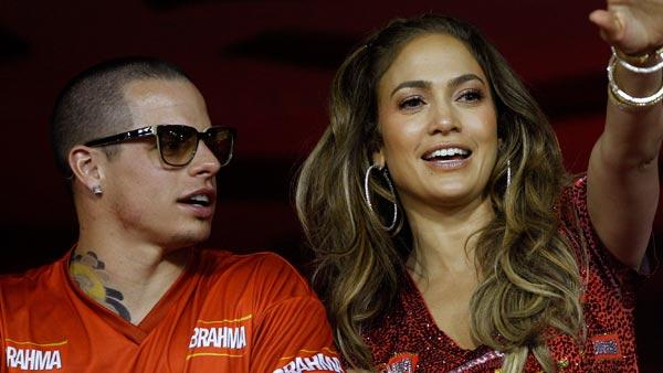 Jennifer Lopez waves to people as she watches carnival parades with Casper Smart at the Sambadrome in Rio de Janeiro, Brazil, Sunday Feb. 19, 2012. - Provided courtesy of AP / Victor R. Caivano