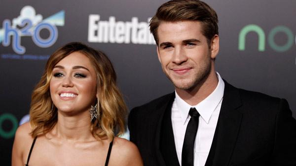Miley Cyrus, left, and Liam Hemsworth arrive at the world premiere of The Hunger Games on Monday March 12, 2012 in Los Angeles. - Provided courtesy of AP / Matt Sayles