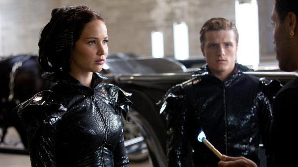 Jennifer Lawrence and Josh Hutcherson a[ppear in a still from The Hunger Games. - Provided courtesy of OTRC / Lionsgate / Murra Close