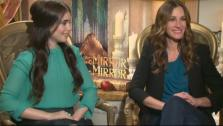 Julia Roberts and Lily Collins appear in a photo from a press junket for their 2012 fairytale film Mirror Mirror on March 23, 2012. - Provided courtesy of OTRC